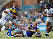 Dom Crosby (C) of Leeds Rhinos tackled by Mourad Kriouache (L) of Toulouse Olympique during the Betfred Super 8s Qualifiers match at Emerald Headingley Stadium, Leeds<br /> Picture by Stephen Gaunt/Focus Images Ltd +447904 833202<br /> 11/08/2018
