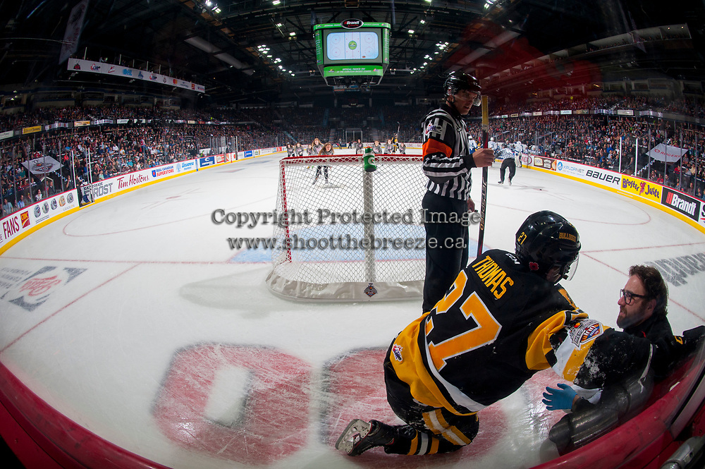 REGINA, SK - MAY 21: Robert Thomas #27 of Hamilton Bulldogs receives on ice attention from the athletic therapist against the Swift Current Broncos at the Brandt Centre on May 21, 2018 in Regina, Canada. (Photo by Marissa Baecker/CHL Images)