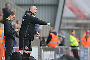 Jim Bentley Manager of Morecambe FC gives instructions to Barry Roche (goalkeeper) of Morecambe FC after Jamie Devitt of Morecambe FC put Morecambe 2-0 up during the Sky Bet League 2 match between Morecambe and AFC Wimbledon at the Globe Arena, Morecambe, England on 12 March 2016. Photo by Stuart Butcher.