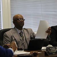 RAY VAN DUSEN/BUY AT PHOTOS.MONROECOUNTYJOURNAL.COM<br /> Ward 1 Alderman Alonzo Sykes, middle, reviews documents during last week's Aberdeen Board of Aldermen meeting. Also pictured are Mayor Maurice Howard and Ward 2 Alderwoman Lady B. Garth.