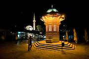 Night shot of pedestrian area with fountain. Sarajevo. Bosnia. Eastern Europe.