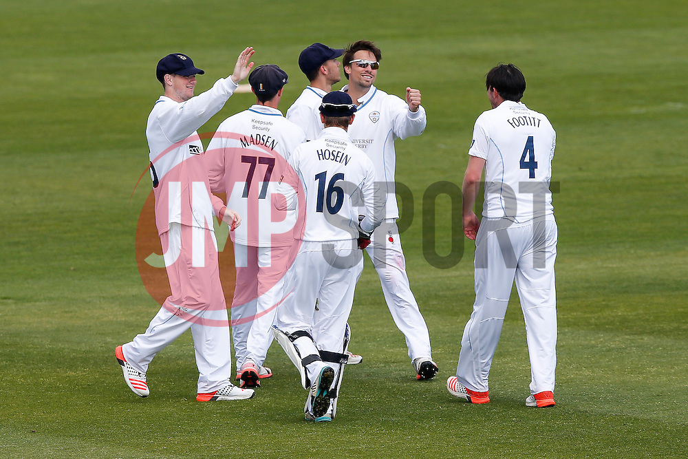 Derbyshire celebrate after Gareth Roderick of Gloucestershire is Caught Out by Alex Hughes (b. Mark Footitt) for 76 - Photo mandatory by-line: Rogan Thomson/JMP - 07966 386802 - 26/04/2015 - SPORT - CRICKET - Bristol, England - Bristol County Ground - Gloucestershire v Derbyshire — Day 1 - LV= County Championship Division Two.
