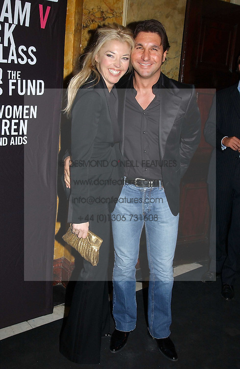 MISS TAMARA BECKWITH and MR GEORGE VERONI at a party to celebrate Pamela Anderson's new role as spokesperson and newest face of the MAC Aids Fund's Viva Glam V Campaign held at Home House, Portman Square, London on 21st April 2005.<br />