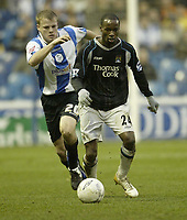 Photo: Aidan Ellis.<br /> Sheffield Wednesday v Manchester City. The FA Cup. 07/01/2007.<br /> city's DaMarcus Beasley comes under pressure from Wednesday's Tommy Spur