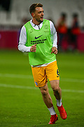 Brighton and Hove Albion midfielder Dale Stephens (6) warms up before the Premier League match between West Ham United and Brighton and Hove Albion at the London Stadium, London, England on 2 January 2019.