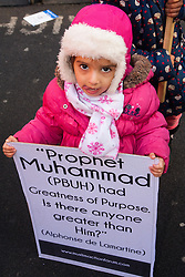 "London, February 8th 2015. Muslims demonstrate outside Downing Street  ""to denounce the uncivilised expressionists reprinting of the cartoon image of the Holy Prophet Muhammad"". PICTURED: A little girl poses for the camera with her placard."