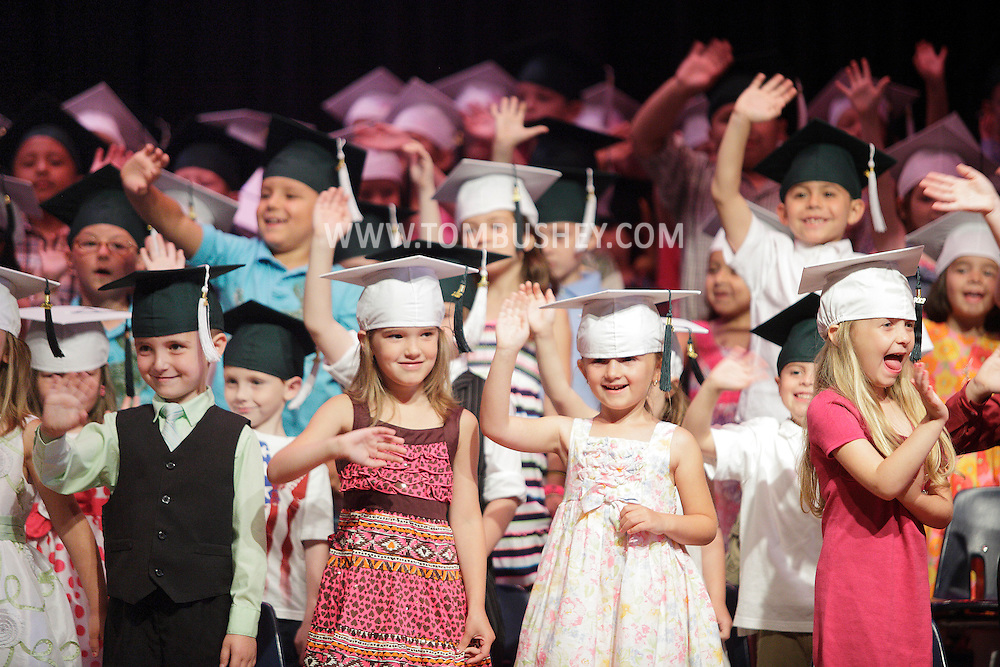 Daniel Dusevic, Kailyn Conklin, Carly Brown and Emma Bello wave to family and friends at the start their kindergarten graduation ceremony at Minisink Valley Elementary School in Slate Hill on Tuesday, June 19, 2012. About 700 relatives and friends watched 167 students graduate.