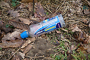 Plastic bottle thrown away in the countryside