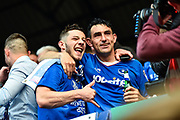 Portsmouth Players Celebrate winning league two on the final day of the season Portsmouth Forward, Conor Chaplin (19) and Portsmouth Midfielder, Gary Roberts (11) during the EFL Sky Bet League 2 match between Portsmouth and Cheltenham Town at Fratton Park, Portsmouth, England on 6 May 2017. Photo by Adam Rivers.