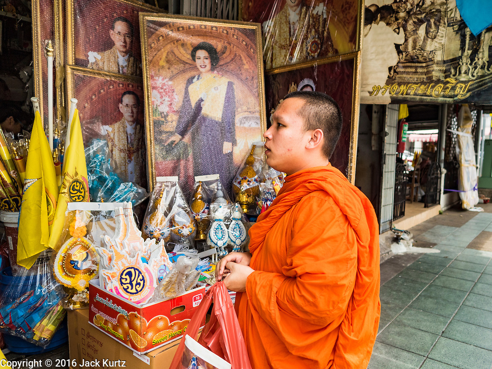 10 AUGUST 2016 - BANGKOK, THAILAND: A Buddhist monk buys supplies to use at his temple on the Queen's Birthday. Thais are preparing for the Queen's birthday. Queen Sirikit of Thailand, was born Mom Rajawongse Sirikit Kitiyakara on 12 August 1932. She married  Bhumibol Adulyadej, King of Thailand (Rama IX) in 1950. He is the longest serving monarch in the world and she is longest serving consort of a monarch. Her birthday, like the King's Birthday (which falls on Dec. 5),  is a national holiday in Thailand. Her birthday, August 12, is also celebrated as Mothers' Day in Thailand. Thais hang portraits of Queen Sirikit in their homes and fly her royal flag on her birthday.        PHOTO BY JACK KURTZ