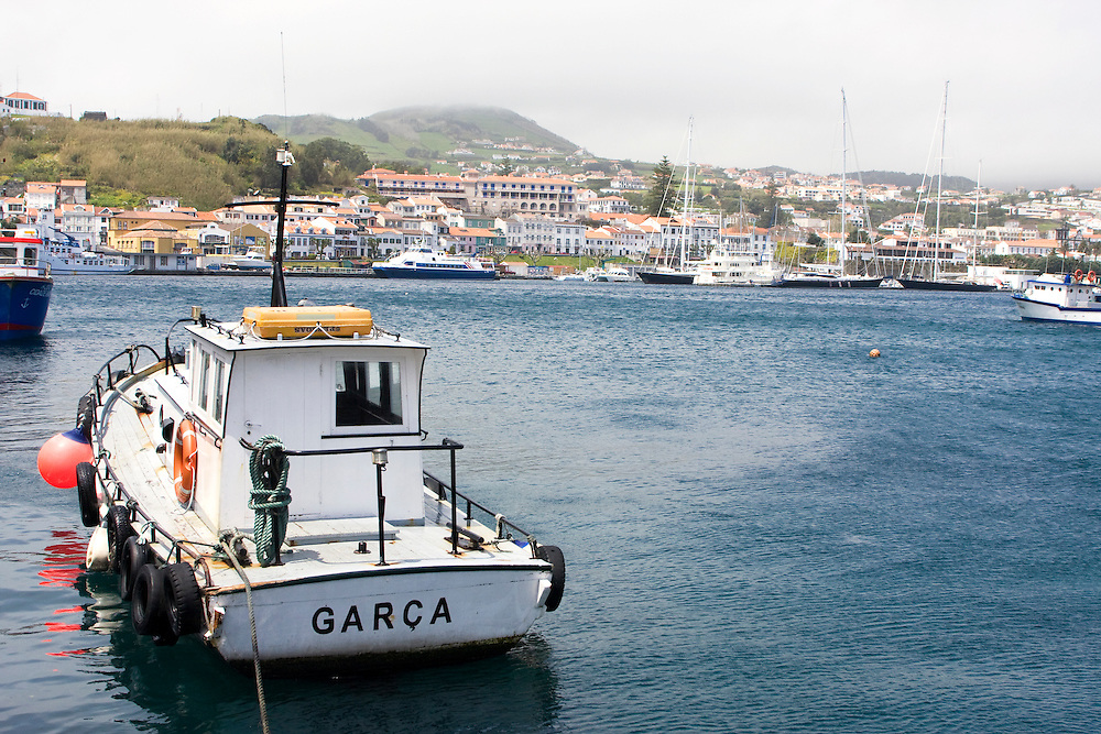 The pilot boat for the commercial harbor in Horta lies tied up to the dock awaiting the next ship to arrive..Horta is on the Portuguese island of Faial, one of the Azores, which mark the most western boundaries of the E.U.