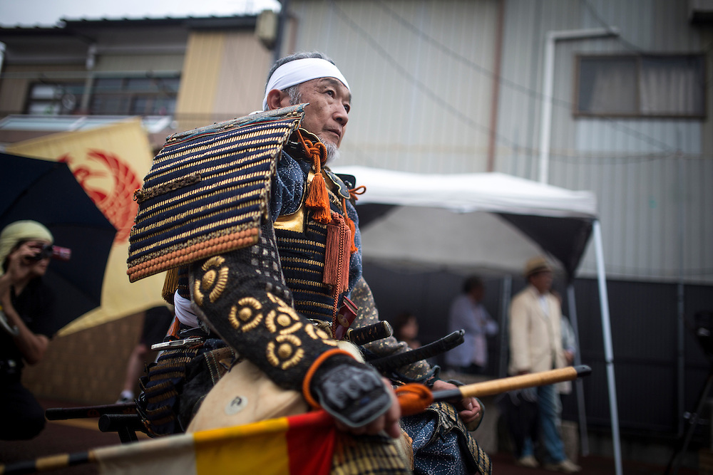 """MINAMISOMA, JAPAN - JULY 24 :  A samurai man is seen during a """"Hon Matsuri"""" parade at the Soma Nomaoi festival at Minamisoma city on Sunday, July 24, 2016 in Fukushima Prefecture, Japan. """"Soma-Nomaoi"""" is a three day traditional festival that recreates a samurai battle scene from more than 1,000 years ago. The festival has gathered more than thousands visitors as Fukushima still continues to recovery from the 2011 nuclear disaster, the samurai warriors battles for recovery of the area. (Photo: Richard Atrero de Guzman/NURPhoto)"""