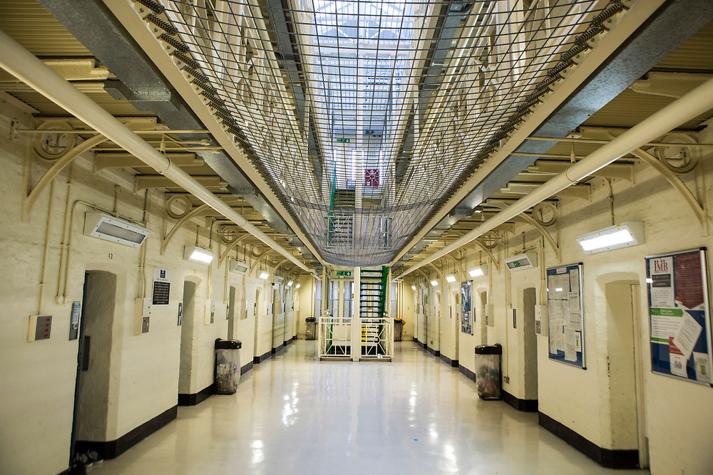 The ground floor central walkway of Benbow wing inside HMP/YOI Portland, a resettlement prison with a capacity for 530 prisoners. Dorset, United Kingdom.