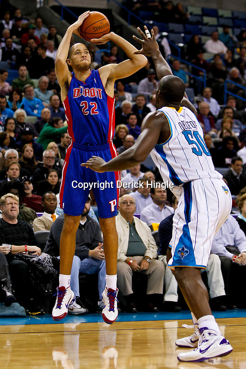 December 8, 2010; New Orleans, LA, USA; Detroit Pistons small forward Tayshaun Prince (22) shoots over New Orleans Hornets center Emeka Okafor (50) during a game at the New Orleans Arena. The Hornets defeated the Pistons 93-74. Mandatory Credit: Derick E. Hingle