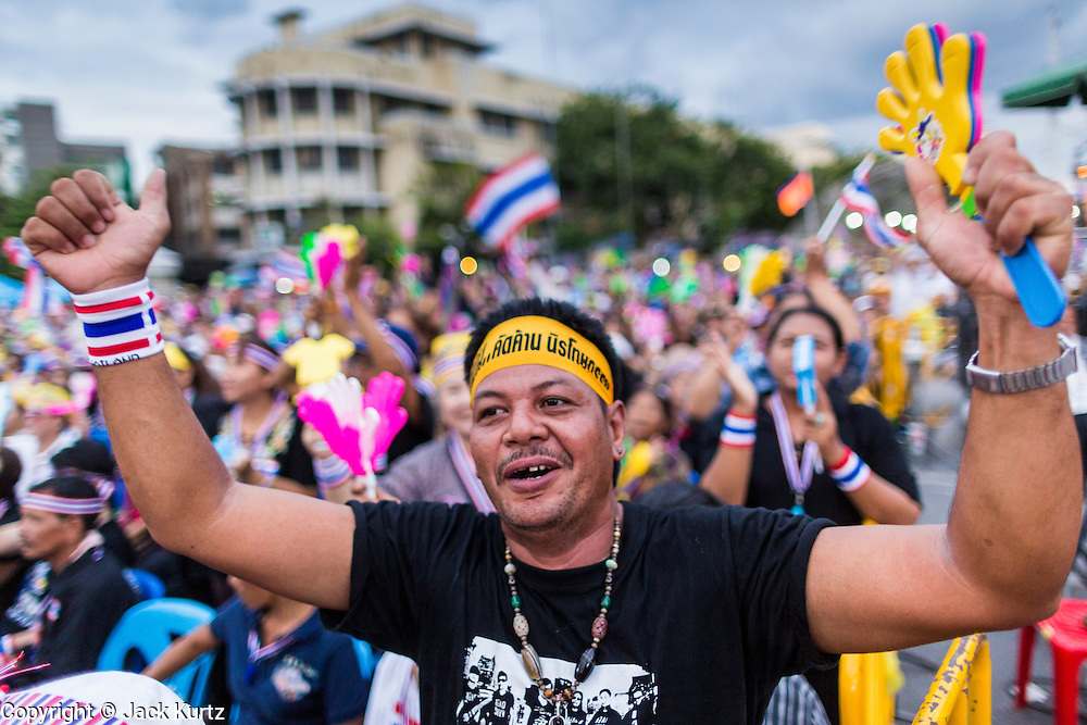 "15 NOVEMBER 2013 - BANGKOK, THAILAND: An anti-government protester cheers during an anti-government protest in Bangkok. Tens of thousands of Thais packed the area around Democracy Monument in the old part of Bangkok Friday night to protest against efforts by the ruling Pheu Thai party to pass an amnesty bill that could lead to the return of former Prime Minister Thaksin Shinawatra. Protest leader and former Deputy Prime Minister Suthep Thaugsuban announced an all-out drive to eradicate the ""Thaksin regime."" The protest Friday was the biggest since the amnesty bill issue percolated back into the public consciousness. The anti-government protesters have vowed to continue their protests even though the Thai Senate voted down the bill, thus killing it for at least six months.     PHOTO BY JACK KURTZ"