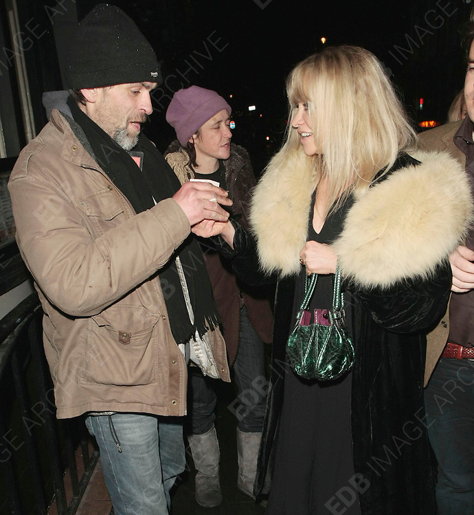 02.FEB.2010-LONDON<br /> <br /> JO WOOD LEAVING GROUCHO PRIVATE MEMBERS CLUB IN SOHO, LONDON AND GIVES A HOMELESS GUY TEN POUNDS.<br /> <br /> BYLINE MUST READ : EDBIMAGEARCHIVE.COM<br /> <br /> *THIS IMAGE IS STRICTLY FOR UK MAGAZINES ONLY <br /> FOR WORLD WIDE SALES AND WEB USE PLEASE CONTACT EDBIMAGEARCHIVE - 0208 954 5968