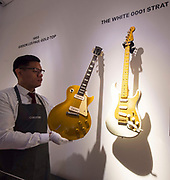 David Gilmour Guitar Collection<br /> Press view<br /> <br /> Gibson Les Paul Gold Top 1955 <br /> <br /> The White Strat 0001 <br /> <br /> The personal guitar collection of rock'n'roll legend David Gilmour, guitarist, singer and songwriter of Pink Floyd is unveiled at Christies, London, Great Britain <br /> 27th March 2019<br /> <br /> For the very first time, Christie's will unveil the much-anticipated preview of the personal guitar collection of rock'n'roll legend David Gilmour, guitarist, singer and songwriter of Pink Floyd, to media on Wednesday 27 March at 9.30am. The first stop for the pre-sale touring exhibition, the view will provide a once in a lifetime opportunity to see the 120+ guitar highlights being sold,<br /> with proceeds to benefit charity.<br />  <br /> The exhibition will be on view to the public from 27 to 31 March 2019. Entry will be free, with timed-tickets.<br /> <br /> Photograph by Elliott Franks