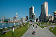 Car traffic on Cinta Costera bayside road. Panama City, Panama, Central America.