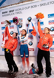 15.12.2017, Olympia Eisbahn, Igls, AUT, BMW IBSF Weltcup und EM, Igls, Skeleton Damen, Siegerpräsentation, im Bild v.l. Elisabeth Vathje (CAN, 2. Platz), Elena Nikitina (RUS, 1. Platz), Mirela Rahneva (CAN, 3. Platz) // f.l. second placed Elisabeth Vathje of Canada winner Elena Nikitina of Russian Federation third placed Mirela Rahneva of Canada during flower ceremony for the women's Skeleton competition of BMW IBSF World Cup and European Championship at the Olympia Eisbahn in Igls, Austria on 2017/12/15. EXPA Pictures © 2017, PhotoCredit: EXPA/ Johann Groder