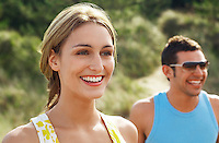 Happy Couple walking on beach trail close up of woman