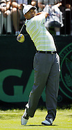 Tiger Woods of the US hits his tee shot on the first hole during the first day of the US Open Golf Championship at Winged Foot Golf Club in Mamaroneck, New York Thursday, 15 June 2006.