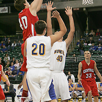 Colt forward Thomas Schmittdiel (40) throws a jump shot over Viking forward Eric Sierbenshuh (40)