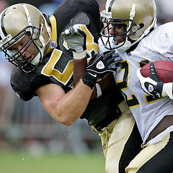 04 August 2009: Saints running back Mike Bell (21) lowers a shoulder into linebacker Mark Simoneau (53) during New Orleans Saints training camp at the team's practice facility in Metairie, Louisiana.