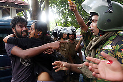 Police Special Task Force commandos forcibly evict students of the Inter University Students' Federation from Health Ministry in Colombo, Sri Lanka, 21 June 2017. Thousands of university students from government universities protest, demanding the abolition of a private medical university of South Asian Institute of Technology and Medicine (SAITM). 96 university students and five STF commandos were wounded and hospitalized in the clash after students forcibly entered the Health Ministry and violated court orders.
