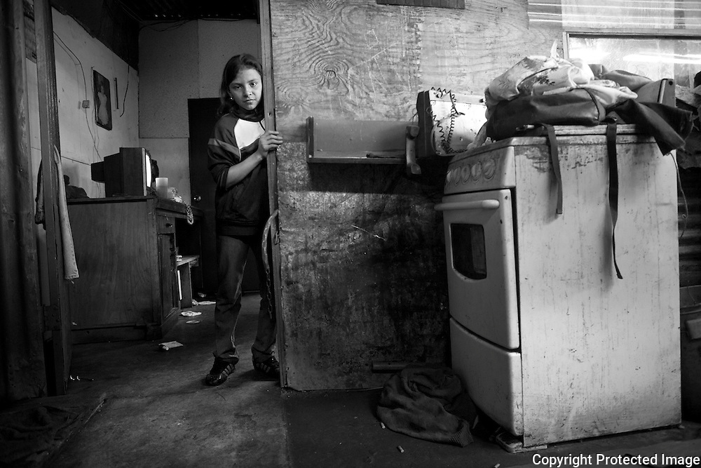 Portrait of Angie in her home in the poverty ridden bario San Felipe