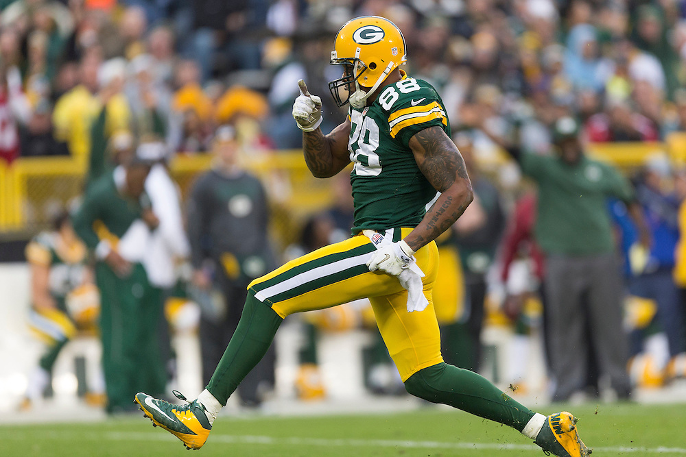 GREEN BAY, WI - DECEMBER 2:  Jermichael Finley #88 of the Green Bay Packers celebrates after a big play against the Minnesota Vikings at Lambeau Field on December 2, 2012 in Green Bay, Wisconsin.  The Packers defeated the Vikings 23-14.  (Photo by Wesley Hitt/Getty Images) *** Local Caption *** Jermichael Finley