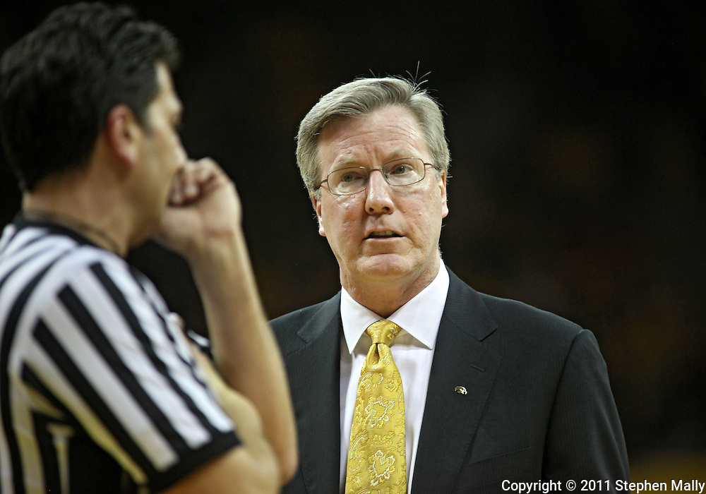 February 09 2011: Iowa Hawkeyes head coach Fran McCaffery talks with an official during the first half of an NCAA college basketball game at Carver-Hawkeye Arena in Iowa City, Iowa on February 9, 2011. Wisconsin defeated Iowa 62-59.