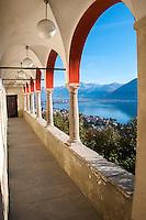 Red arches and colonnade looking over Lago Maggiore from Madonna del Sasso in Locarno, Switzerland