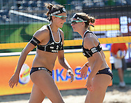 STARE JABLONKI POLAND - July 3: Katrin Holtwick /1/ and Ilka Semmler of Germany in action during Day 3 of the FIVB Beach Volleyball World Championships on July 3, 2013 in Stare Jablonki Poland.  (Photo by Piotr Hawalej)