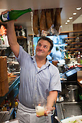 Serving cider at La Viña Bar in San Sebastian, Spain.