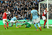 Claudio Bravo (1) of Manchester City grabs the ball after a goal mouth scramble where Pierre-Emerick Aubameyang (14) of Arsenal  nearly scored during the EFL Cup Final match between Arsenal and Manchester City at Wembley Stadium, London, England on 25 February 2018. Picture by Graham Hunt.