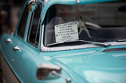 © London News Pictures. 11/05/2013. Hemsby, UK.  A sign in the window of a classic American car at the Hemsby Rock 'n' Roll Weekender  in Hemsby, Norfolk. Twice a year rock and roll enthusiasts gather in the grounds of the Authentic 1950s Seacroft Holiday Site to re-live the 50's by dressing in keeping with the period and listening to live bands playing jive, hop, bop and Rock 'n' Roll. Photo credit: Ben Cawthra/LNP