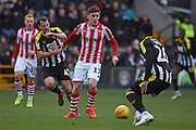 Notts County forward Remaye Campbell (34) battles with Lincoln City forward Shay McCartan (17) during the EFL Sky Bet League 2 match between Notts County and Lincoln City at Meadow Lane, Nottingham, England on 2 February 2019.