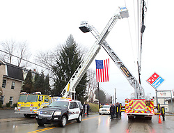 February 21, 2011: A Bridgeport Police Car, that leads the procession, is seen under an American Flag hung by two ladder fire trucks from the Bridgeport Fire Department after the Funeral of deputy U.S. marshal Derek Hotsinpiller.  (Photo by: Ben Queen)