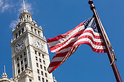 American flag and Wrigley Building on a summers day on Michigan Ave in Chicago, Illinois, USA
