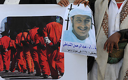 Family members of Yemeni prisoners in Guantanamo display the pictures of them during a rally demanding the release of prisoners held in Guantanamo, in front of the Yemeni President s Palace, in Sanaa, Yemen,  January 14, 2013. Photo by Imago / i-Images...UK ONLY