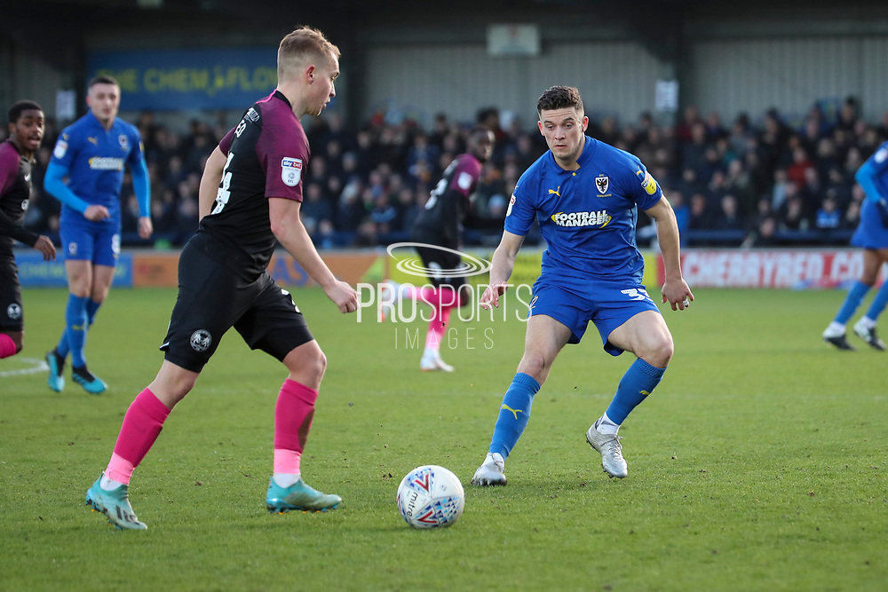 AFC Wimbledon midfielder Callum Reilly (33) battles for possession during the EFL Sky Bet League 1 match between AFC Wimbledon and Peterborough United at the Cherry Red Records Stadium, Kingston, England on 18 January 2020.