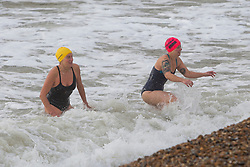 Brighton, UK. 22/11/2016, Members of the Brighton Swimming Club brave the strong wind and powerful waves to go for a swim in the sea in Brighton. Photo Credit: Hugo Michiels