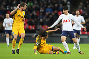 Brighton and Hove Albion defender Ezequiel Schelotto (21) tackling Son Heung-Min of Tottenham Hotspur (7) during the Premier League match between Tottenham Hotspur and Brighton and Hove Albion at Wembley Stadium, London, England on 13 December 2017. Photo by Matthew Redman.