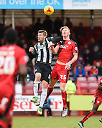 Plymouth forward Ryan Brunt and Crawley Town Defender Josh Yorwerth fight for the ball in the air during the Sky Bet League 2 match between Crawley Town and Plymouth Argyle at the Checkatrade.com Stadium, Crawley, England on 20 February 2016. Photo by David Charbit.