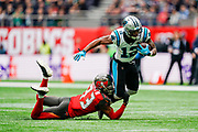 Carolina Panthers Wide Receiver D. J. Moore (12) is tackled by Tampa Bay Buccaneers Defensive Back Carlton Davis (33)  during the International Series match between Tampa Bay Buccaneers and Carolina Panthers at Tottenham Hotspur Stadium, London, United Kingdom on 13 October 2019.