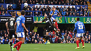 Rommy Boco with the powering header during the Sky Bet League 2 match between Portsmouth and Mansfield Town at Fratton Park, Portsmouth, England on 24 October 2015. Photo by Michael Hulf.
