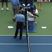 Rafael Nadal, Spain, (right), and Nicolas Almagro, Spain, both receive treatment at the same time during the US Open Tennis Tournament at Flushing Meadows, New York, USA, on Sunday  September 6, 2009. Photo Tim Clayton.