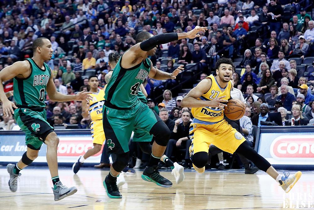 10 March 2017: Denver Nuggets guard Jamal Murray (27) drives past Boston Celtics center Al Horford (42) during the Denver Nuggets 119-99 victory over the Boston Celtics, at the Pepsi Center, Denver, Colorado, USA.