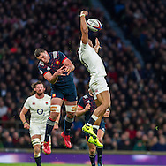 Louis Picamoles and Jonathan Joseph compete for a high ball, England v France in a RBS 6 Nations match at Twickenham Stadium, London, England, on 4th February 2017.