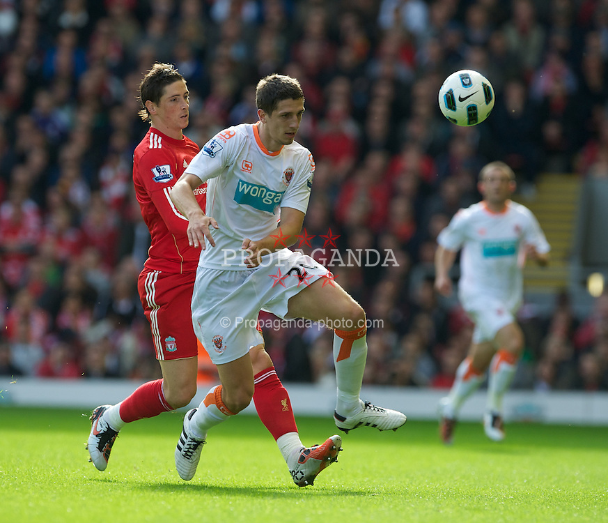 LIVERPOOL, ENGLAND - Sunday, October 3, 2010: Liverpool's Fernando Torres in action against Blackpool's Craig Cathcart during the Premiership match at Anfield. (Photo by David Rawcliffe/Propaganda)